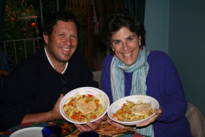 Deanne and her husband holding heart shaped tofu bake, made for them by their kids for their anniversary.